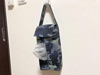 布製ティッシュホルダーにティッシュ箱で手作りした「レジ袋収納Box」を入れ、吊るして使用!